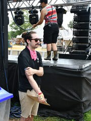 Forrest Dotson, a graduate student in the College of Media and Entertainment, keeps an eye on preparations for his team's work Sunday at the Who Stage at the 2018 Bonnaroo Music and Arts Festival.