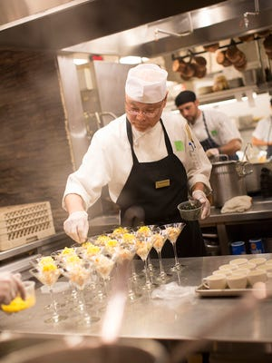 Tadao Mikami prepares a first-Wednesday-of-the-month chef's dinner at Next Door by Wegmans (on a different night than when our writer visited). The dinners blend Japanese foods with cuisines from around the world.