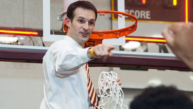 In this file photo, Salisbury University men's basketball coach Josh Merkel pulls down the net following the Gulls victory against Christopher Newport University in the Capital Athletic Conference finals in February. Merkel is resigning from SU in order to take the head coaching job at Division III Randolph-Macon.