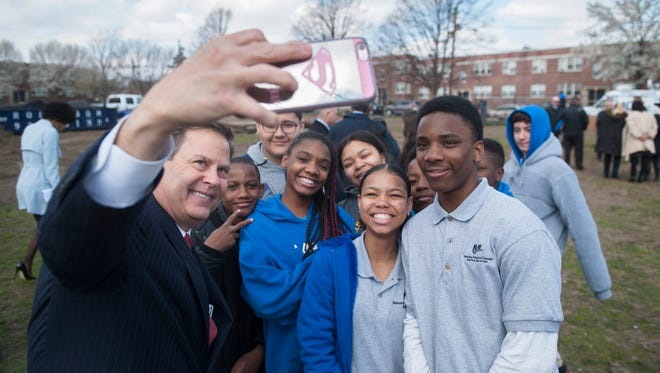 U.S. Rep. Donald Norcross takes a photo with Camden students following a groundbreaking ceremony held at Alberta Woods Park in East Camden to announce plans for renovations of the park.