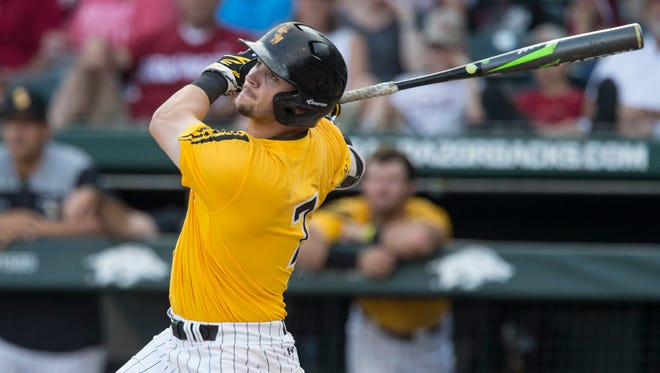 Southern Mississippi's Matthew Guidry pops the ball up for an out in the first inning of an NCAA college tournament regional baseball game against Arkansas, Saturday, June 2, 2018,  in Fayetteville, Ark. (Ben Goff/The Northwest Arkansas Democrat-Gazette via AP)