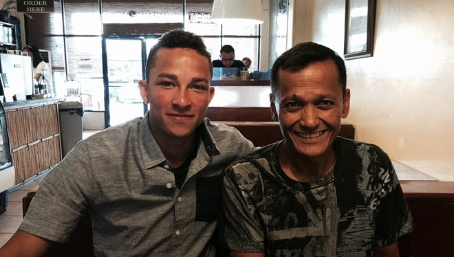 In this PDN file photo, former Guam High School track and field standout Aaron Whitaker joined his former coach Joe Taitano for coffee during the summer of 2015. Whitaker was back from a successful season at Western Oregon University, where he set the fastest 400-meter run marks for the school's 2014 and 2015 outdoor seasons, according to Athetlic.net. On Feb. 19, Whitaker broke the school's record with a 48.53 time in the men's indoor 400m.