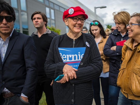 Vivian Jordan of Shelburne waits for Democratic presidential candidate Vermont Sen. Bernie Sanders to arrive at the Burlington International Airport in South Burlington on Wednesday, June 8, 2016.