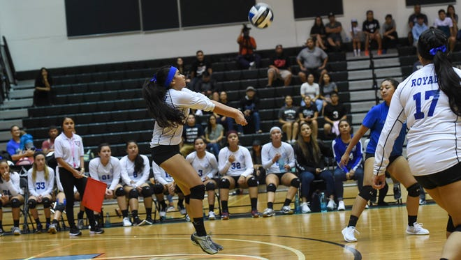In this file photo from October 2017, league Most Valuable Player Carlie Quinata passes the ball during the the IIAAG Girls Volleyball championship game against the St. John's Knights  at the University of Guam Calvo Field House.