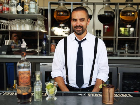 The Continental Bar Manager Barry Larkin with his craft cocktail, My Blueberry Buck.