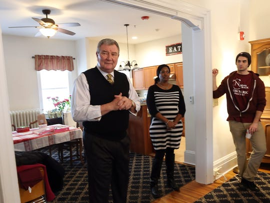 Homeless Solutions Director of Housing Thomas M. Clark, l,  speaks to Valentine volunteers from Newmark Associates, putting the finishing touches on the $1.5M renovation project that was completed last year at the Mt. Kemble Home, a historic landmark offering affordable housing to senior women in Morristown. February 14, 2017, Morristown, NJ.