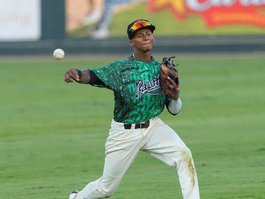 Visalia Rawhide shortstop Sergio Alcantara fires the