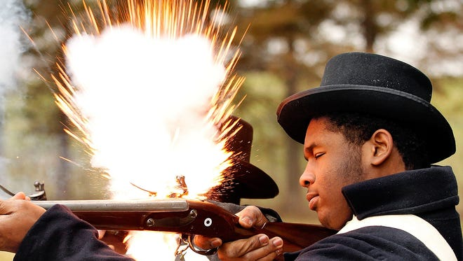 McDonogh High School student Dyiriell Jenkins fires a blank from a replica Springfield musket during a living history lesson in 2911 at Chalmette Battlefield in Chalmette. Jenkins portrayed a member of the Free People of Color militia, who fought in the Battle of New Orleans.