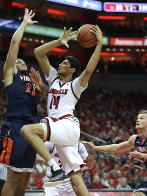 Louisville's Anas Mahmoud drives to the basket early in the game against Virginia. March 1, 2018.