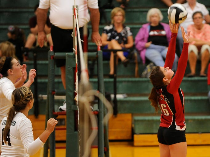 Northridge's Savannah Legg and Jamie Swickard prepare to block as Utica's Brooke Maxwell sets up a teammate for a hit. The Redskins defeated the Vikings in three straight sets on Thursday, Aug. 21, 2014