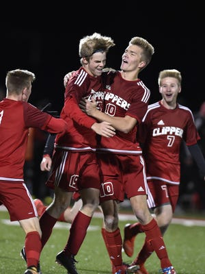 Jaden Stevenson, center right, celebrates with younger brother Owen, who scored the winning goal with to win the WIAA Division 4 sectional championship Saturday night in Lomira. Joining the celebration are brothers Eli Dietzel, left, and Eb Dietzel, right.