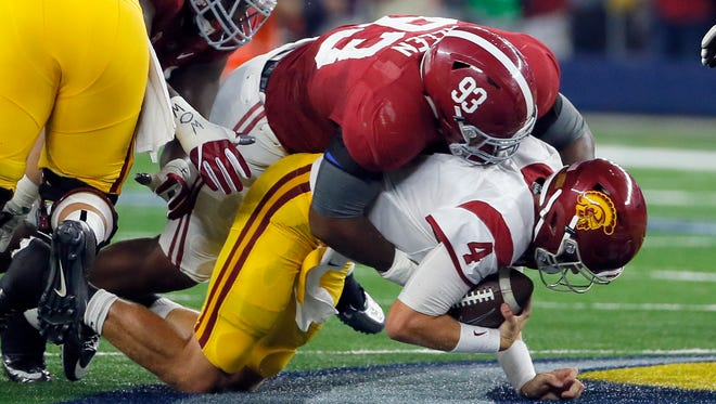 Southern California quarterback Max Browne (4) is sacked for a 5-yard loss by Alabama defensive lineman Jonathan Allen during the first half of an NCAA college football game Saturday, Sept. 3, 2016, in Arlington, Texas. (AP Photo/Tony Gutierrez)