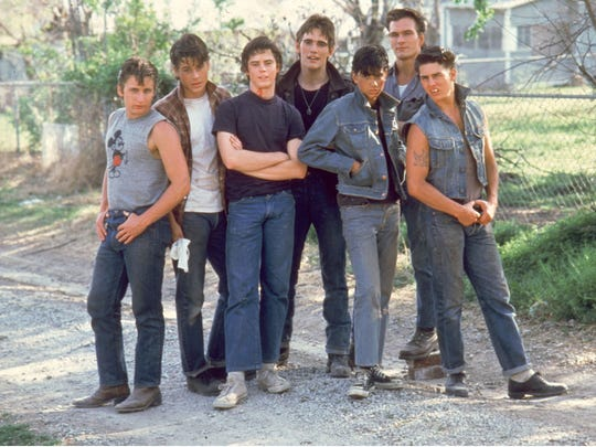 """Cast members from the 1983 film """"The Outsiders,"""" from left, Emilio Estevez, Rob Lowe, C. Thomas Howell, Matt Dillon, Ralph Macchio, Patrick Swayze and Tom Cruise."""