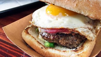 Brown calls the Croque Garcon, served at Block 16 in Omaha, his favorite hamburger in the country. It's made with a 1/3-pound burger, cheese, ham, a sunny-side-up egg, mustard and truffle mayo on a ciabatta roll.