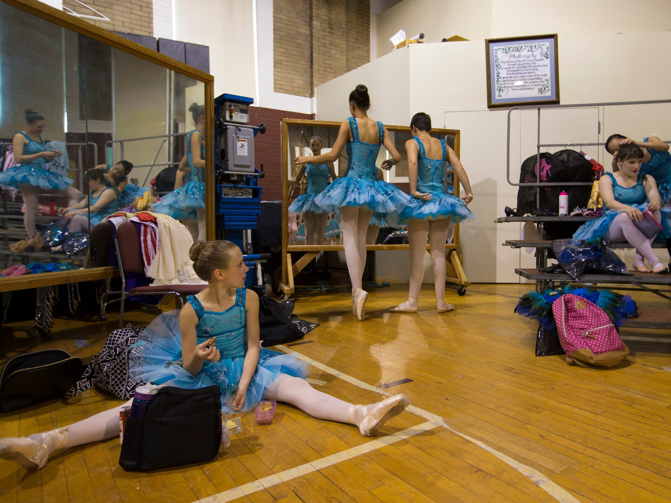 Ballet dancers prepared backstage for a dress rehearsal at the Clifton Center. In foreground is Dara Zaharik, age 11. May 18, 2017.