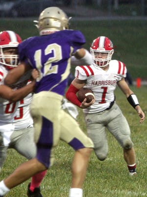 Harrisburg senior running back Wyatt Robinson rushed for 317 yards and five touchdowns Friday to guide the Bulldogs to a solid 36-0 football victory at Salisbury in Lewis & Clark Conference play.