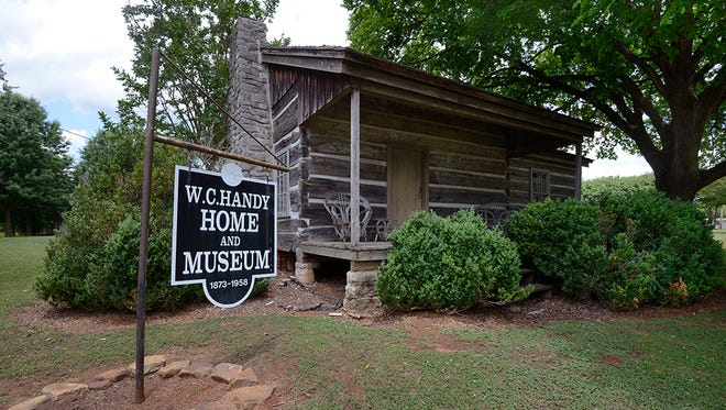 """Inside the W.C. Handy Birthplace, Museum and Library in Florence, which is in a log cabin in which Handy was born in 1873, visitors can see his trumpet, his handwritten music and the piano on which he composed """"St. Louis Blues."""""""