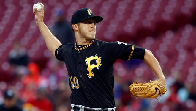 Pirates starting pitcher Jameson Taillon throws a pitch against the Reds at Great American Ball Park in Cincinnati.