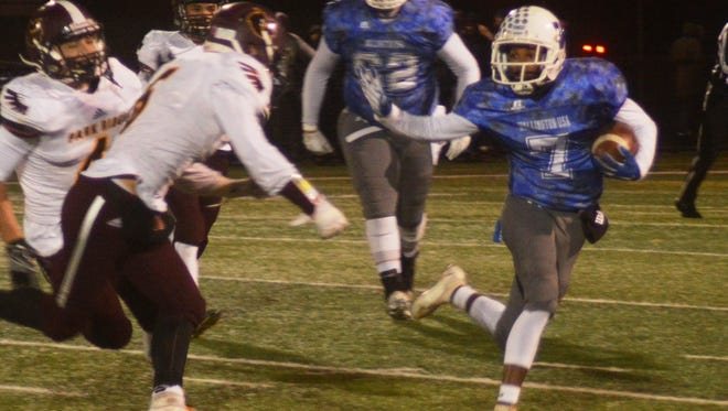 Wallington wide receiver Zaheir Mitchell giving a stiff arm to a Park Ridge defender in the North 1, Group 1 playoffs.