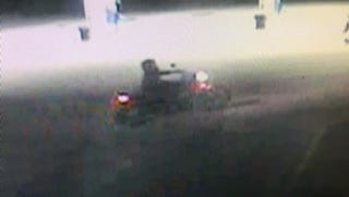 This is one surveillance still of the suspect and his motorcycle.
