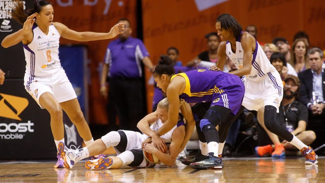 Mercury guard Erin Phillips and Sparks forward Candace Parker battle for the ball during the third quarter of the WNBA Western Conference semifinals on Aug. 22, 2014, at US Airways Center in Phoenix.
