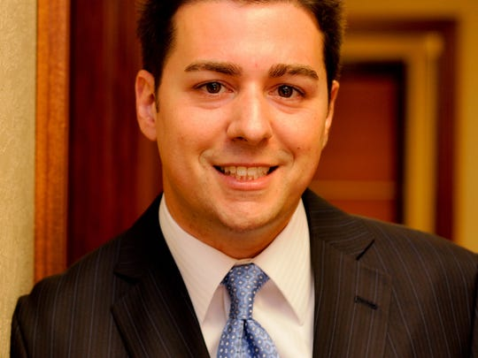 Carlos Dias Jr., a wealth manager and financial adviser