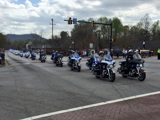 A procession leads fallen officer Allen Jacobs to his final resting place in Travelers Rest on March 24, 2016.