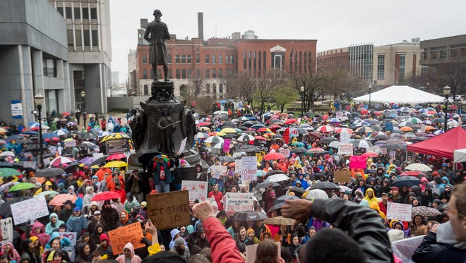 Students from area schools, and concerned members of the community, gather near Louisville Metro Hall during a protest to end gun violence in Louisville, Ky, March 24, 2018.
