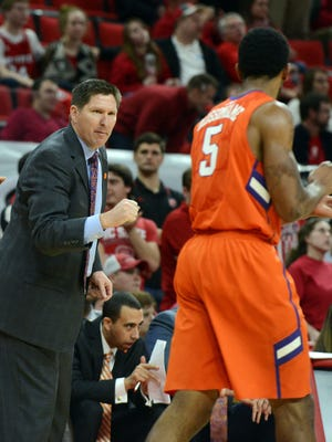 Jan 28, 2015; Raleigh, NC, USA; Clemson Tigers head coach Brad Brownell (left) gestures to forward Jaron Blossomgame (5) during the second half against the North Carolina State Wolfpack at PNC Arena. The Tigers won 68-57.