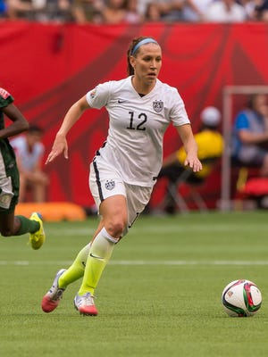 Lauren Holiday #12 of the United States runs with the the ball during the FIFA Women's World Cup Canada 2015 Group D match between Nigeria and The United States June, 16, 2015 at BC Place Stadium in Vancouver, British Columbia, Canada. (