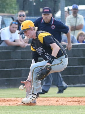 Trenton Peabody's Cade Roberts (9) fields a ground ball against Huntingdon in the Region 7-A championship on Wednesday at Huntingdon.
