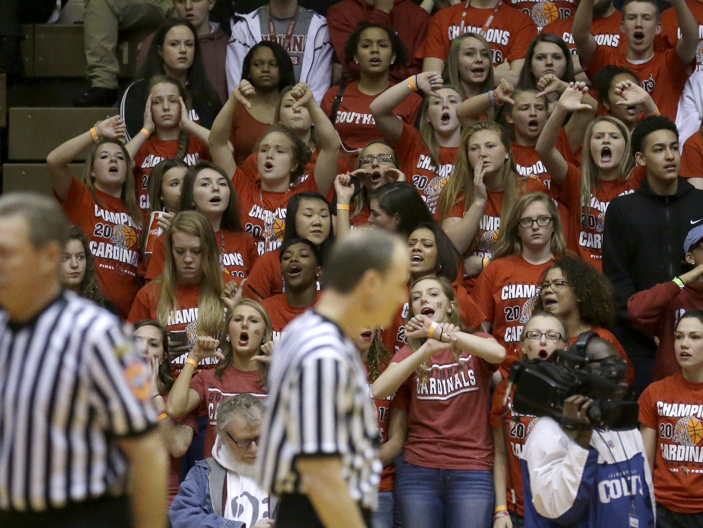 Student fans from Southport give their opinions to the IHSAA officials in the second half of their Class 2A semistate March 19, 2016, at Richmond High School. More and more now days basketball referees and officials are getting harassed by fans, students and parents.
