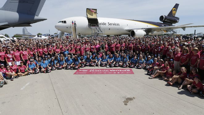A thousand WomenVenture attendees showed up for the annual photo Wednesday, July 25, 2018, in Boeing Plaza at EAA AirVenture 2018 in Oshkosh.
