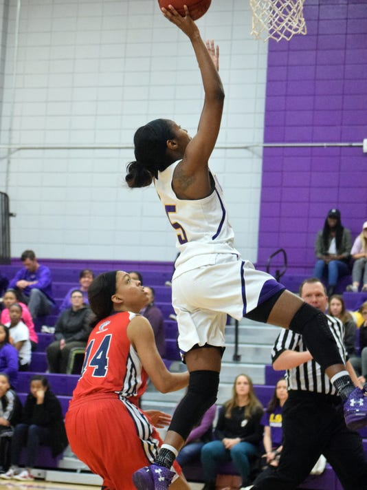 LSUA's Luv Blackburn (5, right) goes for two against the University of the Southwest Saturday at the Fort.