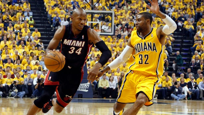 Miami Heat guard Ray Allen (34) drives to the basket against Indiana Pacers guard C.J. Watson (32) in game two of the Eastern Conference Finals of the 2014 NBA Playoffs at Bankers Life Fieldhouse.