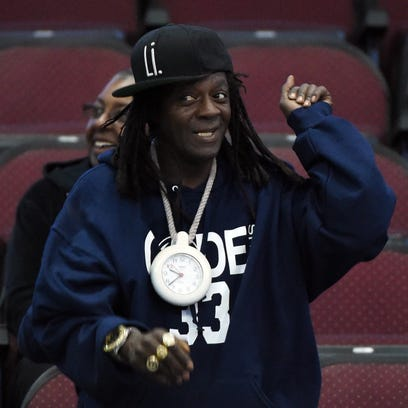 Rapper Flavor Flav dances in the stands during a game between the Penn State Nittany Lions and the Kent State Golden Flashes during the 2015 Continental Tire Las Vegas Classic basketball tournament in December.