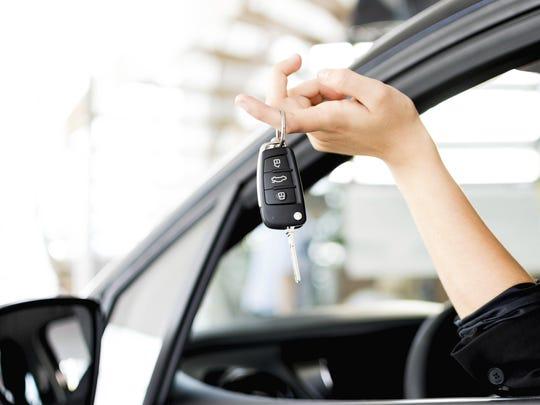 Stock image: Driver showing car keys.