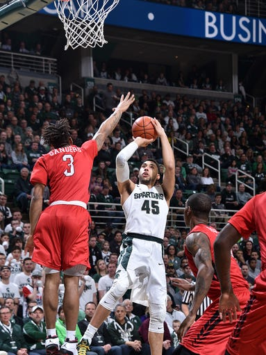 Denzel Valentine puts in the first basket of the night