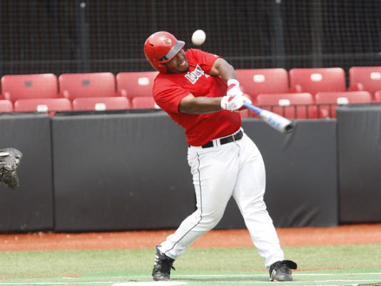 Asaad Ali, a member of the University of Louisville baseball team, takes a swing during an early June practice. (By