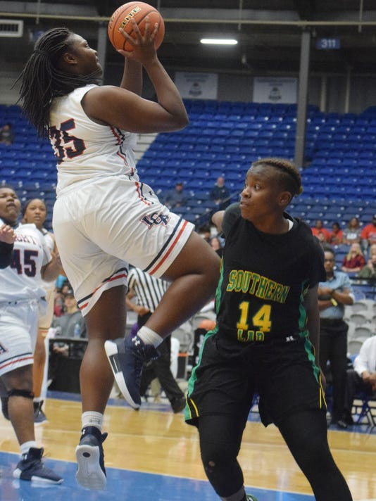 Lafayette Christian's Bre Porter (35, left) shoots two against Southern Lab's Darien Carter (14, right) in the LHSAA Division IV semifinals held Thursday, Feb. 22, 2018 at the Rapides Parish Coliseum in Alexandria.