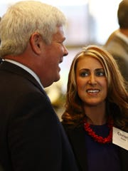 Attorney Christy Keele mingles with the crowd before the 20 Under Forty award program.