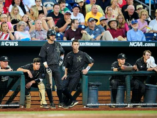 Vanderbilt players watch from the dugout during the fifth inning against Virginia in the College World Series at TD Ameritrade Park, Monday, June 22, 2015, in Omaha, Neb.