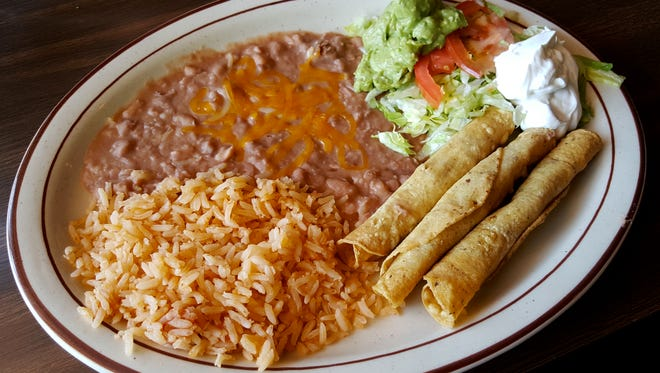 Nellie's Cafe has been serving up savory New Mexican dishes since 1967. Pictured is the flauta plate ($8.25) that comes with three flautas, beans, lettuce and tomato, guacamole, sour cream and rice.