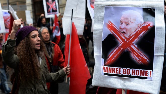 Turkish students stage a rally to protest against the visit of  Vice President Biden in Istanbul.