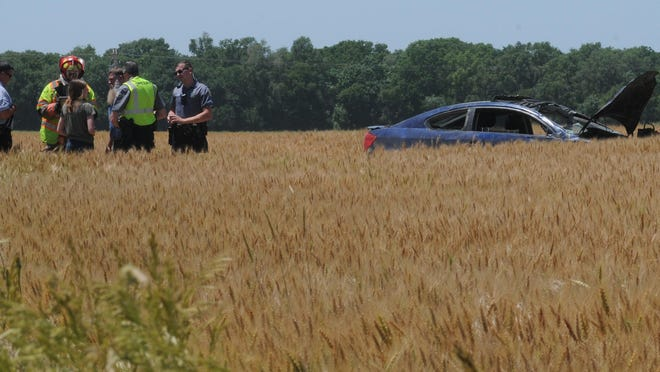 Salina County emergency responders investigate a rollover accident that had two girls, a 16-year-old and 14-year-old, inside the vehicle when the vehicle rolled off of the side of the 5300 block of West Crawford Street and into a wheat field on Friday afternoon.