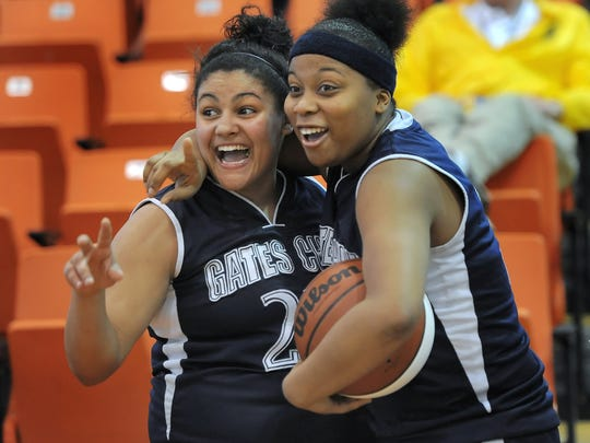 Kori Bayne-Walker, left, was the 2013 All-Greater Rochester Player of the Year as a senior. The next season, Cierra Dillard, right, took over sole leadership of the Spartans and earned the same honor after leading them to a third Section V crown in four years.