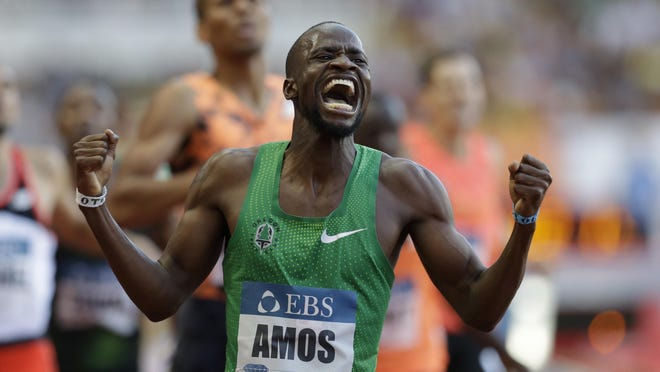 Botswana's Nijel Amos, who runs for the Oregon Track Club, celebrates after winning the 800 in a world-leading time of 1 minute, 42.14 seconds in Monaco.