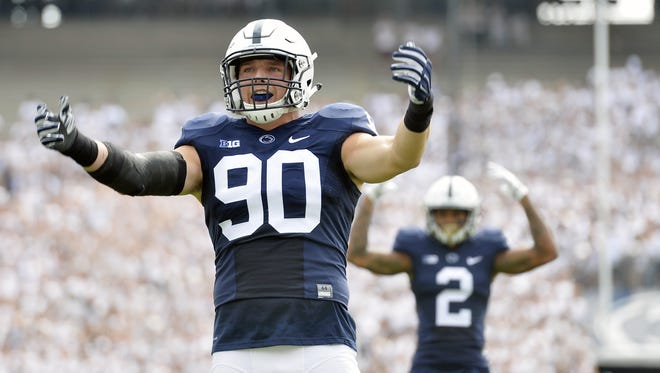 Defensive end Garrett Sickels (90) has turned up the intensity in a big way to lead a most diverse line that comes in waves.