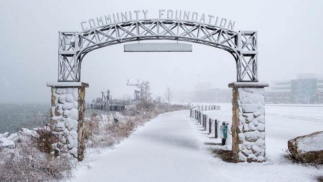 The arch on the Blue Water River Walk is covered in wet snow March 1.
