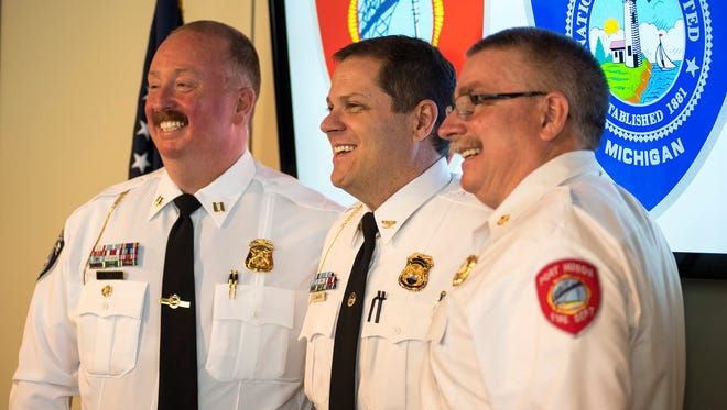 Port Huron Police Captain Joseph Platzer, left, stands with chief Jeff Baker, center, and fire chief Dan Mainguy after being named the next police chief by city manager James Freed Wednesday, April 18. Both Baker and Mainguy have announced their retirement.